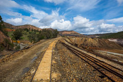Train tracks. Landscape in sapin with train tracks, mountains and clouds Stock Image