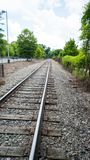 Train tracks to somewhere. Train tracks leading of into the distance somewhere Stock Photography