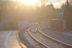 Train Tracks leading into the morning light stock photography