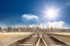 Train tracks leading to city Stock Image
