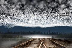 Train tracks leading to city Royalty Free Stock Image