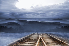 Train tracks leading to mountains Royalty Free Stock Photos