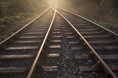 Train tracks leading to the sunset Stock Photography