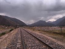 train tracks and meadow royalty free stock photos