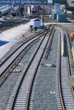 Train tracks merge and divide at active train station stock images