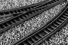 Train tracks. Model train tracks with gravel. Black and white stock photo