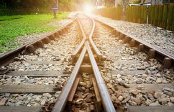 Free Train Tracks On Gravel, Two Of Railways Tracks Merge  With Sunset Background, Concept Of Success Stock Photo - 150687060