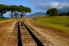 """Train Tracks. Photo taken near the Ko Olina resort on Oahu. """"Neither a wise man nor a brave man lies down on the tracks of history to wait for the train of the Stock Photo"""