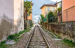 Train tracks pov in Pisogne - Iseo Lake - Brescia Stock Photo