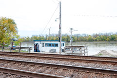 Train tracks river. Train tracks run parallel to a river in a rustic pastoral scene with a bait shop and boat ramp Royalty Free Stock Photo