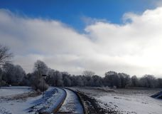 Train tracks in the snowy woods Royalty Free Stock Image