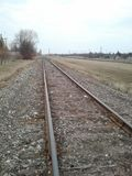Train Tracks in the Springtime. Run Down old Train Tracks in the Springtime on an overcast day in Winnipeg, Manitoba, Canada, vertical Royalty Free Stock Photos