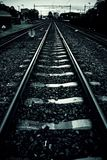 Train tracks in a station. Transport detail by rails, trip royalty free stock images