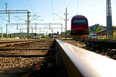 Train tracks and sun flare. Some train tracks and a locomotive at Halden train station, frog perspective with sun flare Royalty Free Stock Images