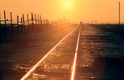 Train Tracks Sunset Winter Saskatchewan. Industry Stock Photo