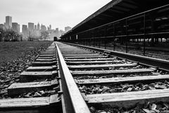 Train Tracks to Manhattan. A black and white of train tracks with Manhattan in the background stock photography