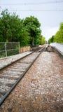 Train tracks to somewhere. Train tracks leading of into the distance somewhere Stock Photo