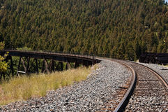 Train tracks and trestle. A railroad track and trestle winding through the mountains in Montana Royalty Free Stock Photography