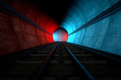 Train Tracks And Tunnel Split Choices. A brick underground train tunnel  that splits into two directions in the distance each distinctly coloured blue and red Royalty Free Stock Photos