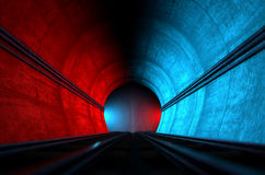 Train Tracks And Tunnel Split Choices. A brick underground train tunnel  that splits into two directions in the distance each distinctly coloured blue and red Stock Images