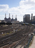 Train tracks at Victoria. Converging train track junctions with Battersea power station in the background Stock Photo