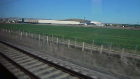 Train tracks view,green landspace, 2016. The view from the windows of the high-speed train track stock video footage