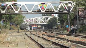 TRAIN TRACKS: View of tracks with distant train approaching stock footage