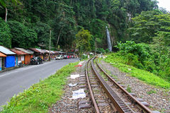 TRAIN TRACKS & WATERFALL IN SUMATRA Stock Photo