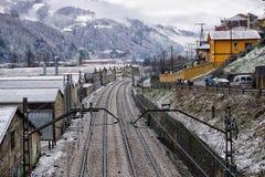 Train tracks in the winter snow. stock photo