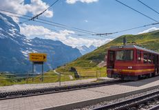 The train at the train station Kleine Scheidegg in the Bernese Oberlands the region of Switzerland at the altitude of. 6762 feet. Kleine Scheidegg, Switzerland royalty free stock photo