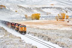 Train transporting tank cars. Season changing autumn to winter. stock images