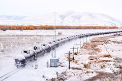 Train transporting tank cars. Season changing autumn to winter. stock photos