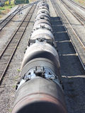 The train transports oil in tanks . Tanks with oil stand in a row at railway station having extended afar Royalty Free Stock Images