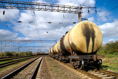 The train transports tanks with oil. Back part of the train transporting tanks with oil Stock Images