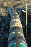 The train transports tanks with oil and fuel. Wagons of a freight train transporting oil Stock Photo