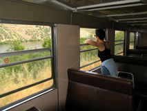 Train travel. Girl looking at the window of a train Royalty Free Stock Photo