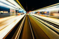 Train travel blur. Blur from moving train at night Stock Photo