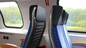 Train travel. Concept - seats in interior of modern passenger car in motion stock video footage