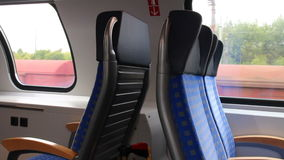 Train travel. Concept - seats in interior of modern passenger car in motion stock video