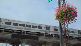 Train traveling along an elevated track station platform. A Train traveling along an elevated track station platform stock video