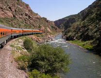 Train traveling along the river. Royalty Free Stock Images