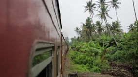 The train is traveling around Sri Lanka.  stock video