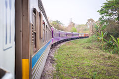 Train traveling through the countryside, Thailand Royalty Free Stock Photos