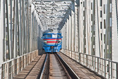 Train traveling on the iron bridge Royalty Free Stock Photography