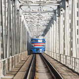 Train traveling on the iron bridge Stock Photo