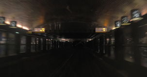 Train traveling through the tunnel and coming to station stock footage