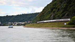 Train travelling along Rhine river Stock Photos