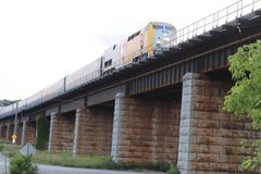 Train travelling over trestle royalty free stock photography