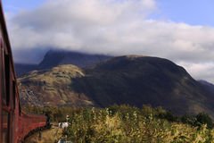 Train travelling towards Ben Nevis, Scotland royalty free stock images