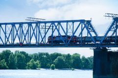 The train travels along the railway bridge stock photo